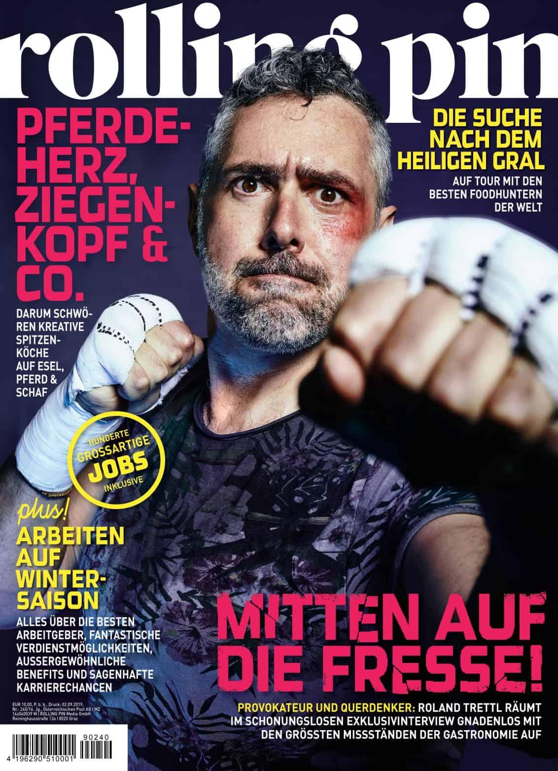 Roland Trettl mit ernstem Blick, blauem Auge und Box-Outfit am Cover des Magazins Rolling Pin